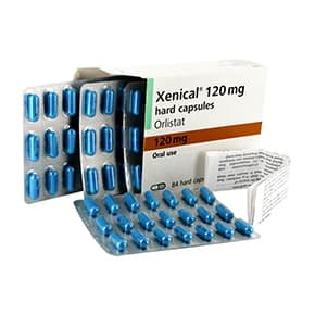 Box of Xenical 120mg capsules with blister packs and patient information leaflet
